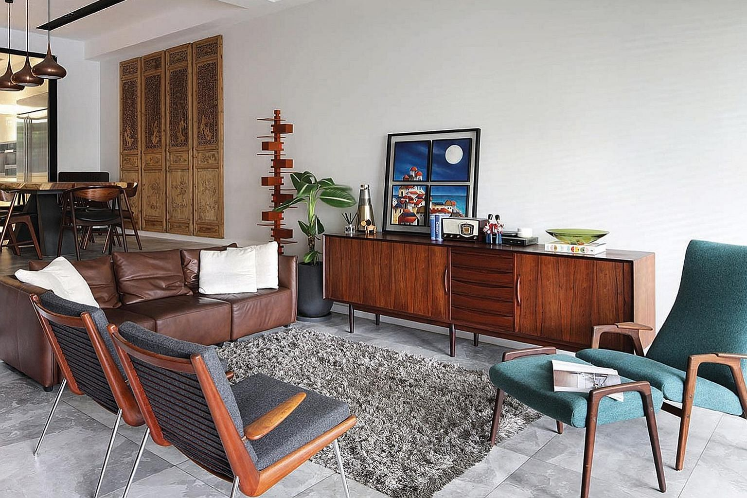 The look of the living area may be part minimalist and part vintage, but when brought together, harmonise to form a cosy and inviting interior.