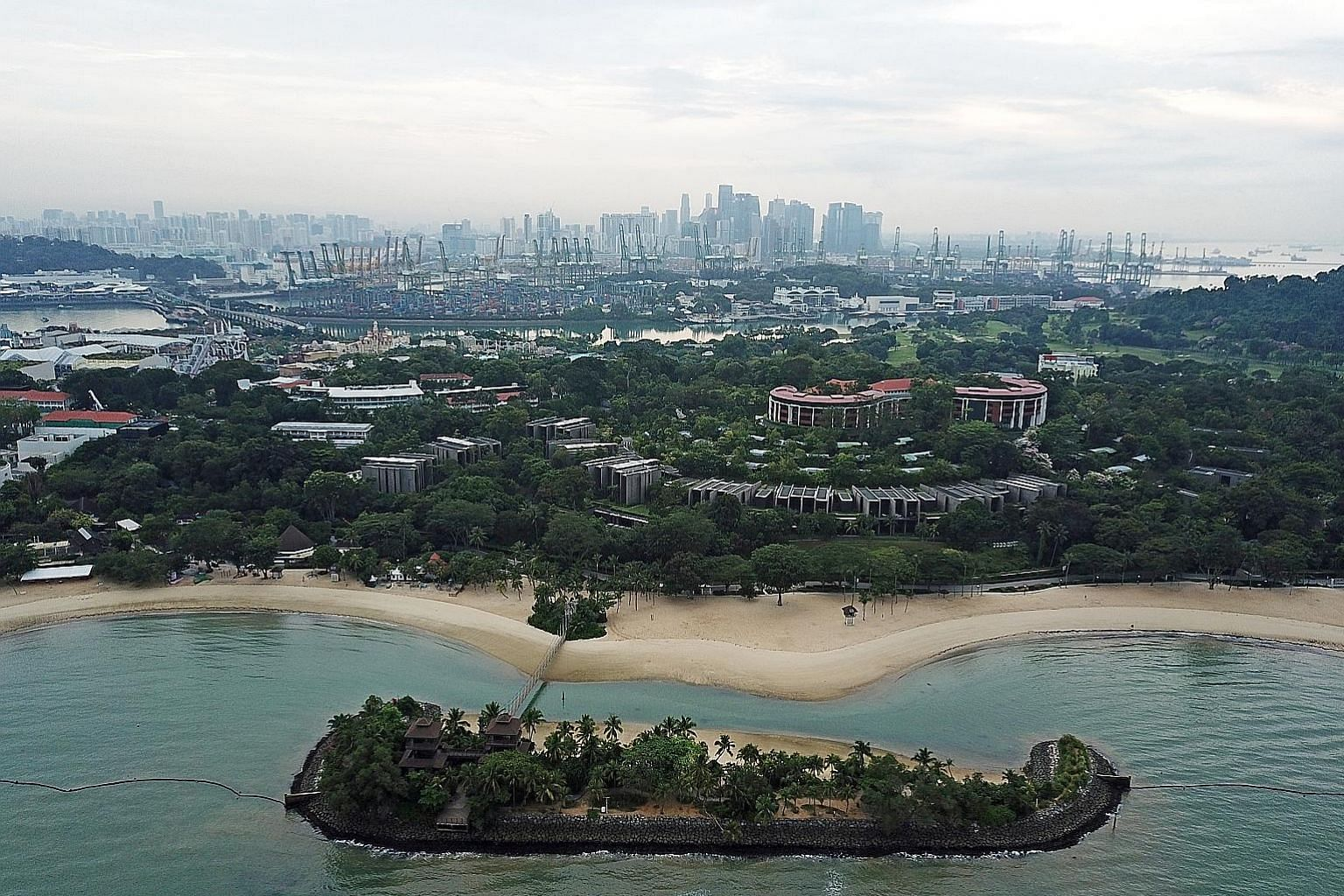"""Palawan Beach in Sentosa is in the foreground. Behind it is the main Sentosa island, while Pulau Brani, where a """"Downtown South"""" resort may be built in the future, can be seen in the background."""