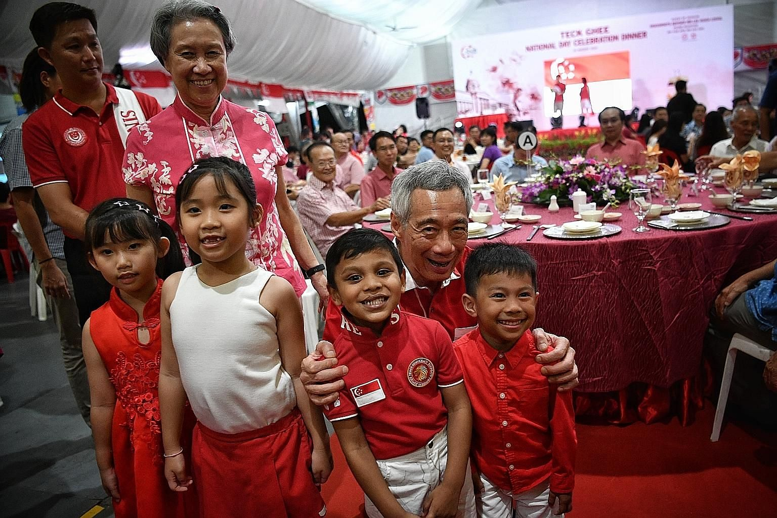 Prime Minister Lee Hsien Loong and Mrs Lee with young guests at the Teck Ghee National Day celebration dinner yesterday, which was attended by about 2,500 Teck Ghee residents and guests.