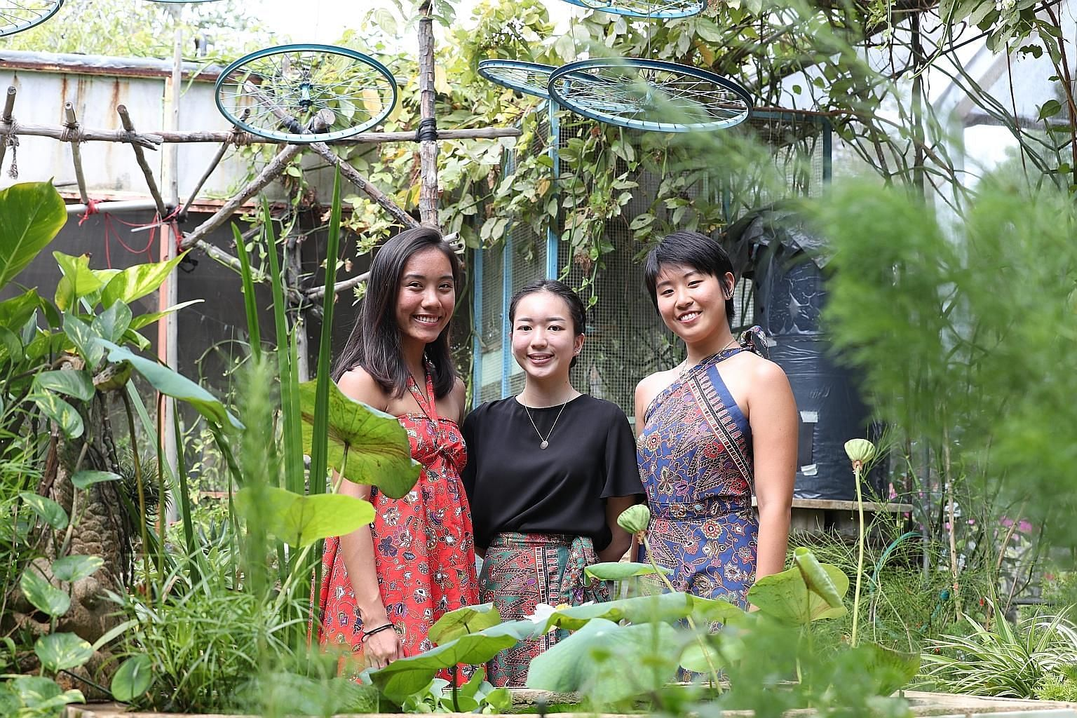 "From left: Ms Goh Yu Xuan, Ms Maria Tan and Ms Chuang Xue Ying wearing recycled clothes for a ""kampung girl"" vibe at Ground Up Initiative in Yishun."
