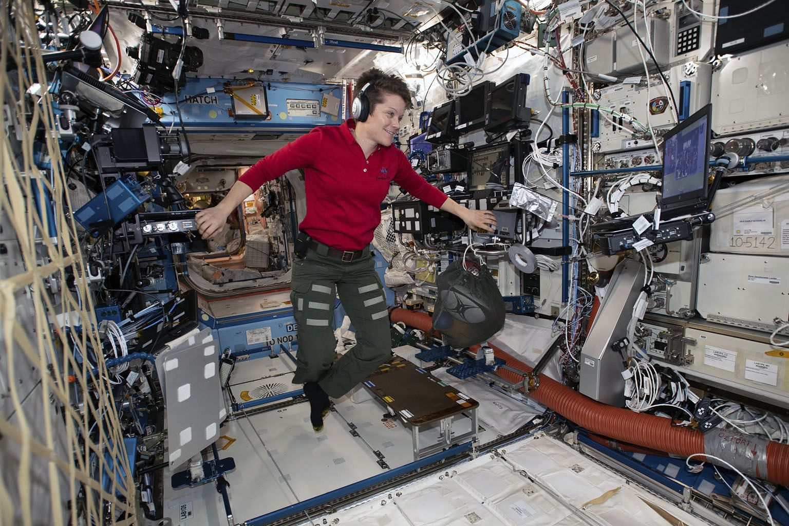 Astronaut Anne McClain looking at a laptop computer screen in the US Destiny laboratory module of the International Space Station. Nasa is checking a claim that she improperly accessed the bank account of her estranged spouse from the space station.