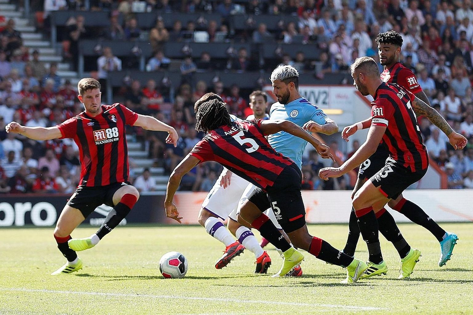 Sergio Aguero slaloming through a sea of defenders to convert Manchester City's third goal. It was the Argentinian striker's second of the game as he ended Bournemouth's resistance. PHOTO: REUTERS