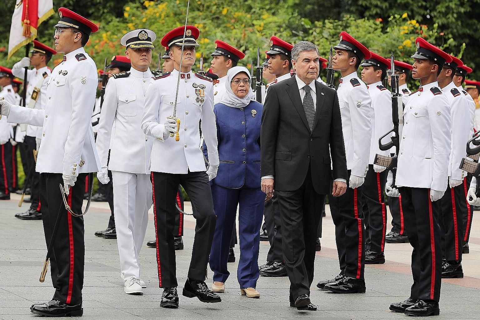 Turkmenistan President Gurbanguly Berdimuhammedow, accompanied by Singapore President Halimah Yacob, reviewing the guard of honour at the Istana yesterday. He left Singapore last night.