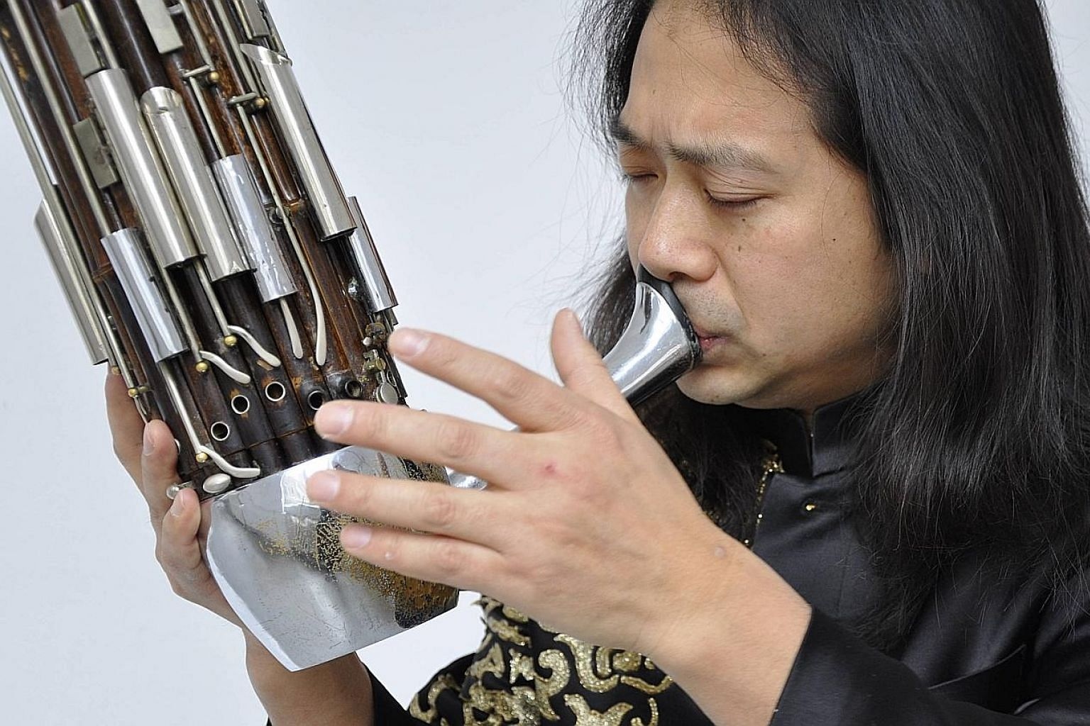 Sheng virtuoso Wu Wei (above) will take centre stage in the Earth & Fire sheng concerto while The Butterfly Lovers' Violin Concerto will feature violinist Kam Ning.