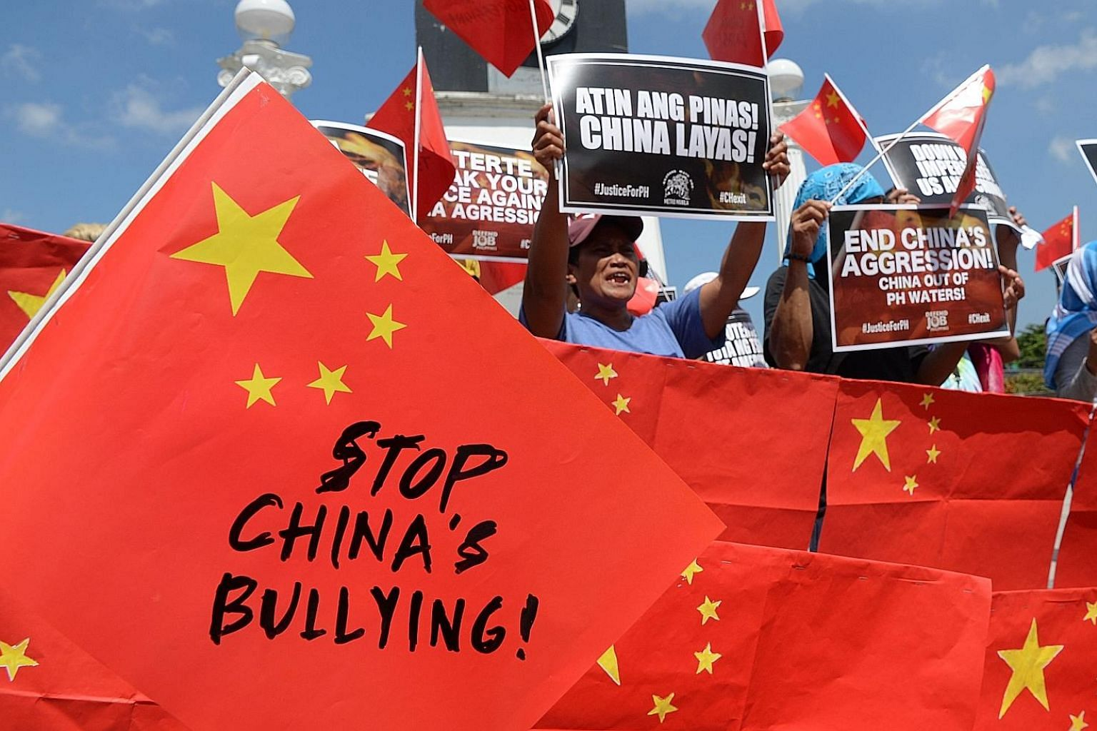 An anti-China rally in Manila in June after a Chinese vessel collided with a Philippine fishing boat in the South China Sea, causing it to sink. Philippine President Rodrigo Duterte, who has so far resisted calls to press a 2016 tribunal ruling on th