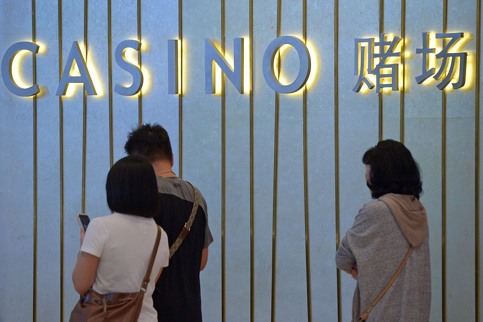 The success of Singapore's integrated resorts is a testament to their legislative framework, but the buoyant market climate suggests there might still be room to raise the casino tax, the writer says. ST FILE PHOTO