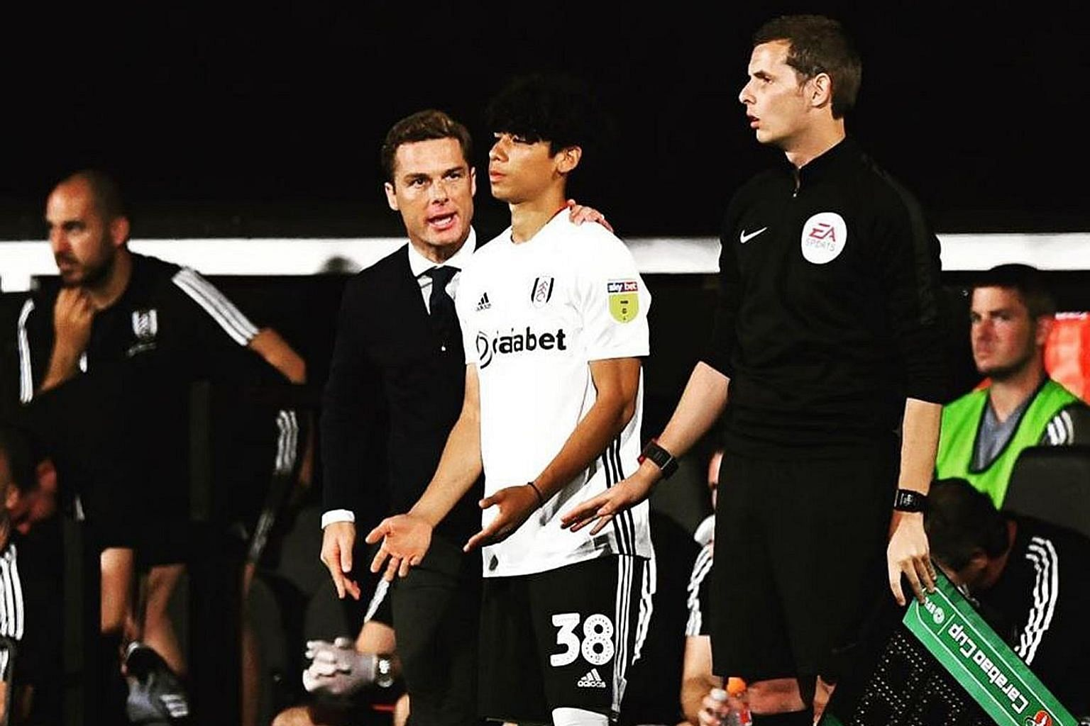 Ben Davis, 18, receiving instructions from manager Scott Parker before coming on against Southampton in the League Cup. It was the teenager's first senior appearance for Championship side Fulham. PHOTO: INSTAGRAM/ BEN_JAMES_DAVIS