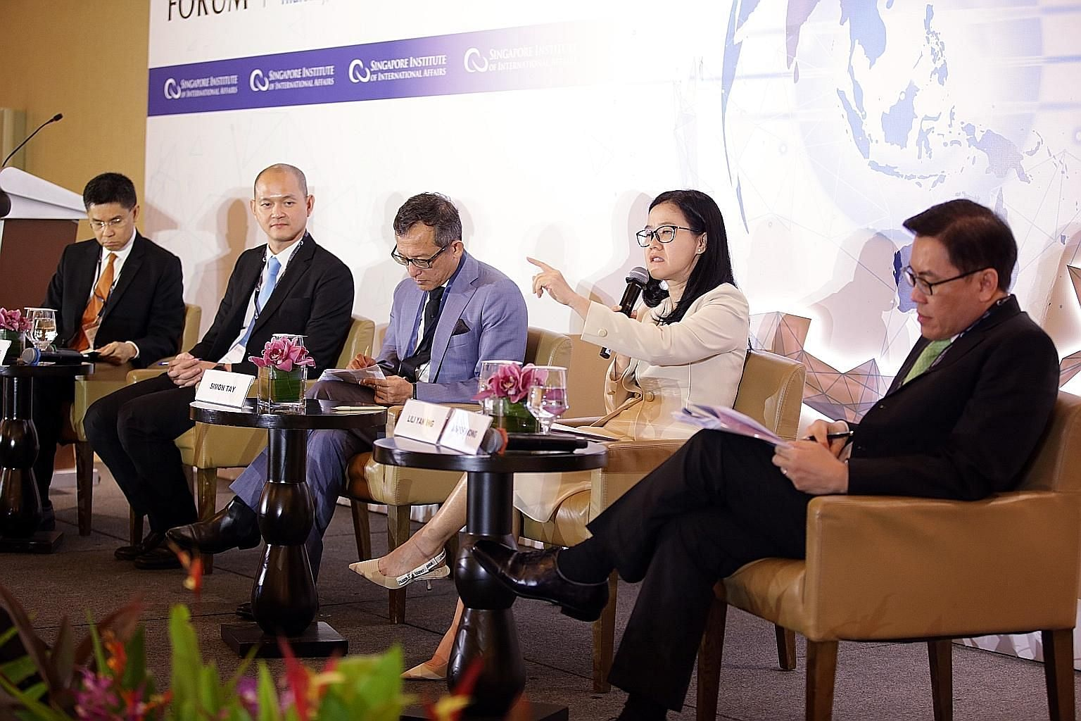 At the 12th Asean and Asia Forum yesterday were (from left) Dr Panitan Wattanayagorn, associate professor at Chulalongkorn University; Dr Ong Kian Ming, Malaysia's Deputy Minister for International Trade and Industry; Singapore Institute of Internati