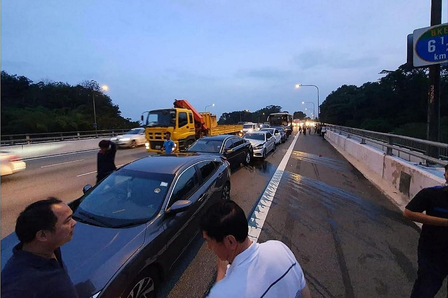 The chain collision on Bukit Timah Expressway on Wednesday involved six cars and a bus. Four people were taken to hospital.