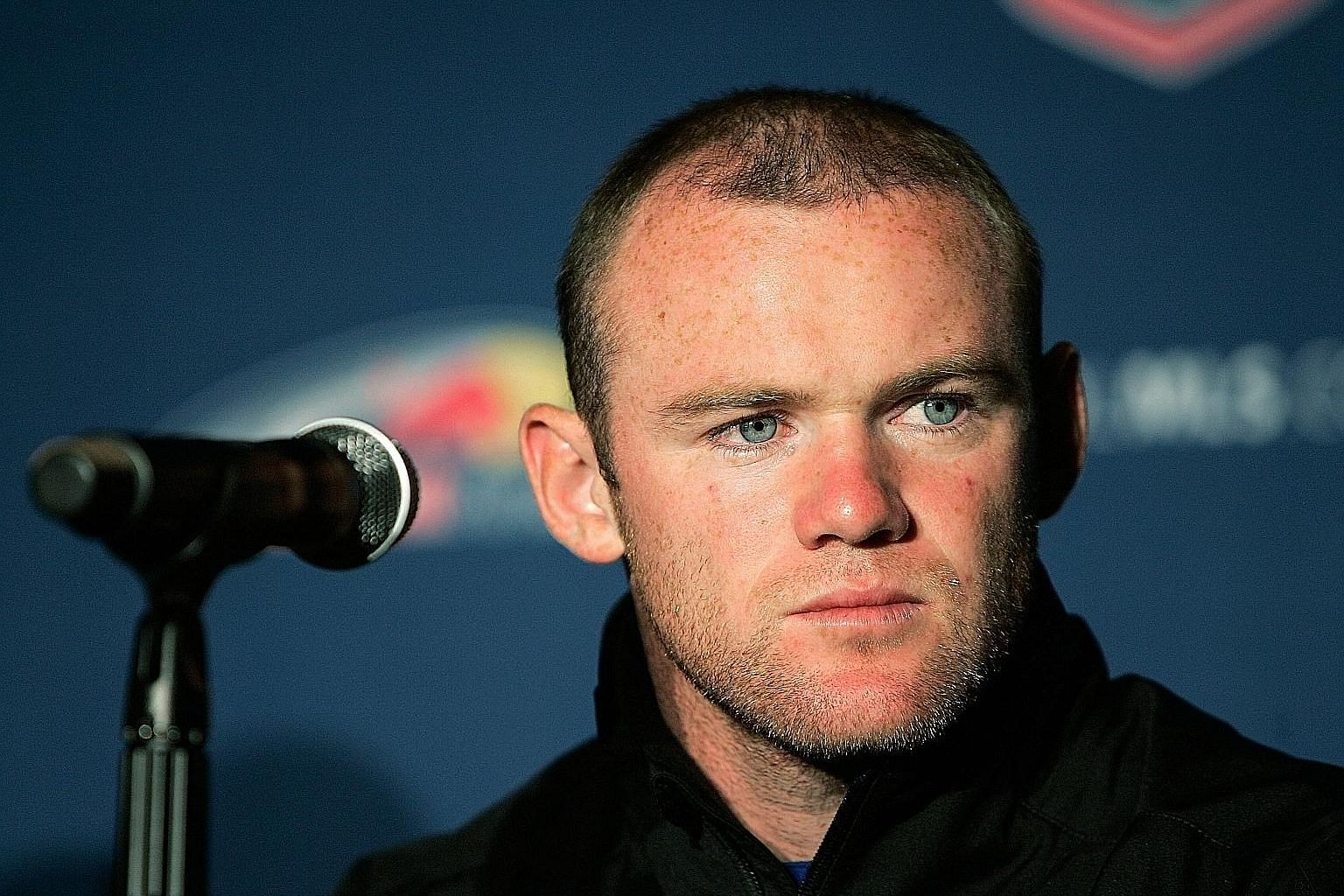 "Wayne Rooney says The Sun's story and photos were a smear against him, making it ""look like I took a girl back to my team hotel"" in Vancouver."