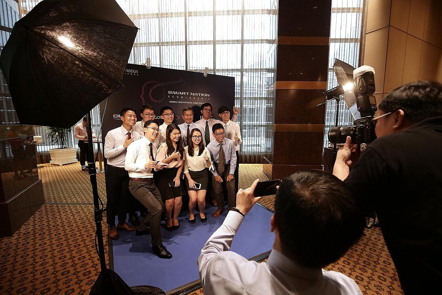 Minister-in-charge of the Smart Nation Initiative Vivian Balakrishnan (back row, fourth from left) with the pioneer batch of Smart Nation Scholarship recipients at last year's award ceremony. To build a Digital Government, we need to hire peak techni