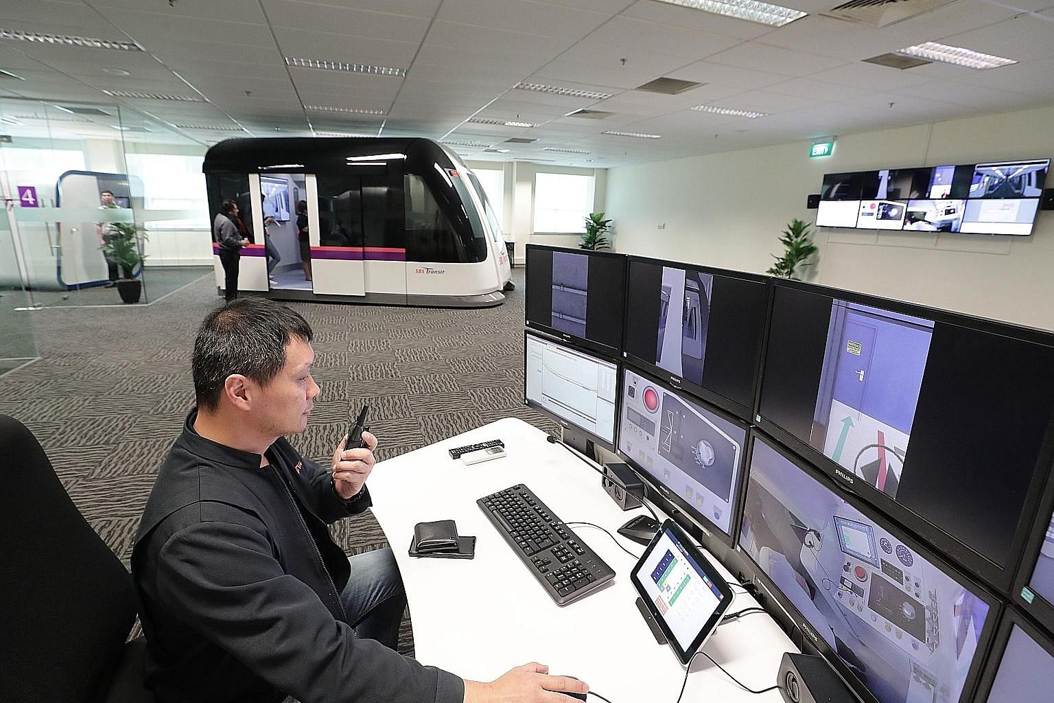 SBS Transit trainer Renzo Chua, 48, conducting training with the help of a train driving simulator for drivers, in order to prepare them for emergency situations on the North East Line or Downtown Line. The simulator is among initiatives aimed at boo