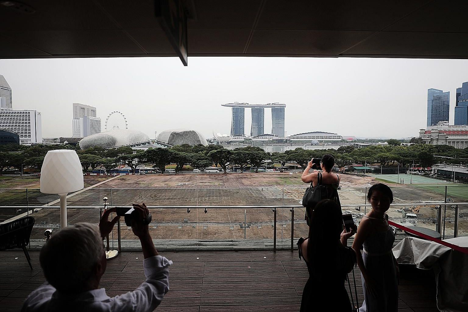 The Padang, photographed last Wednesday, with patches of brown following last month's National Day Parade. Work is under way to returf the expanse ahead of the Singapore Grand Prix, which will be held in the area later this month.
