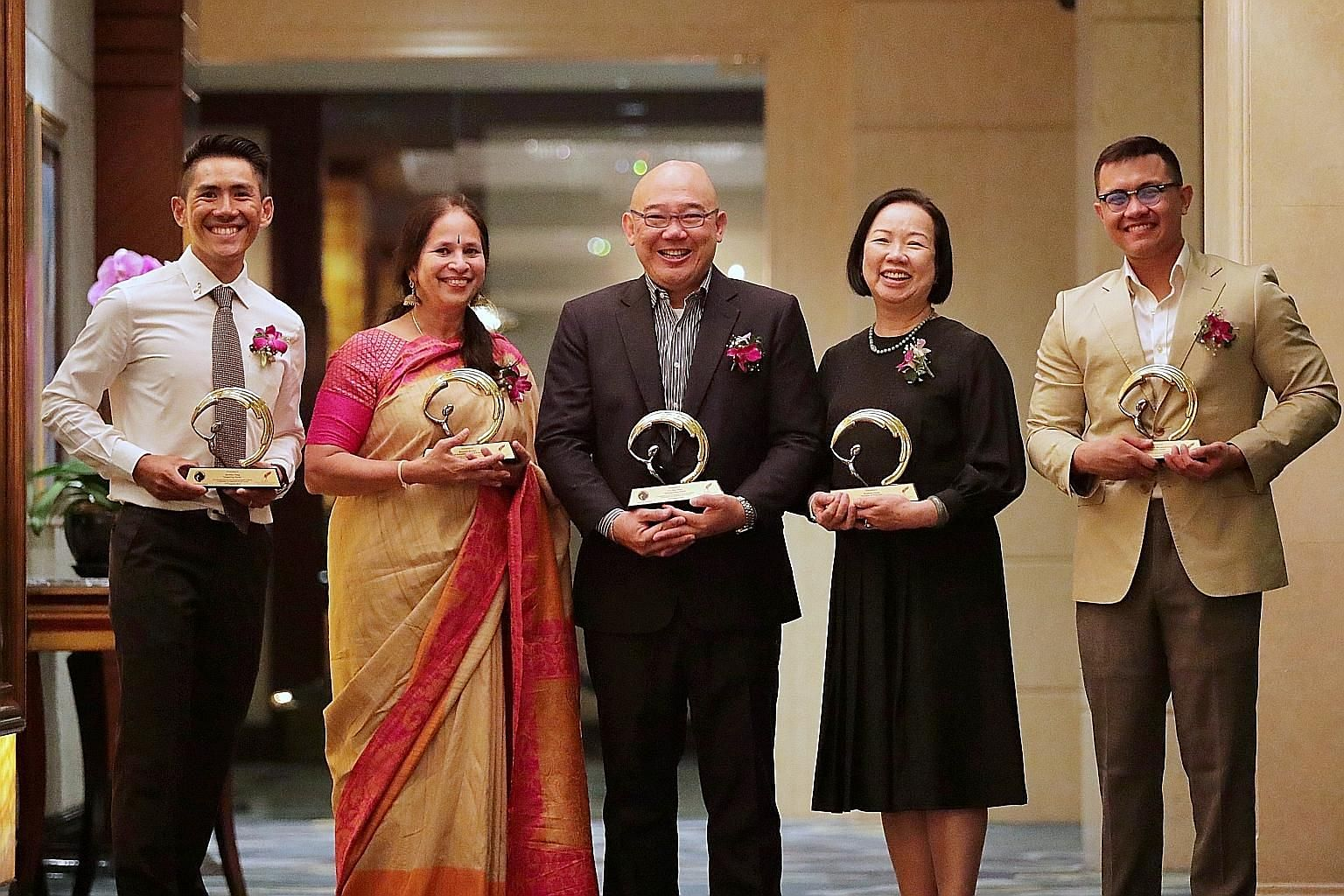 (From far left) Mr Jeremy Tong, Dr Bhavani Sriram, Mr Foo Say Thye, Madam Rowena Leong and Mr Aminur Rasyid Mohamed Anwar were the five winners of the Silent Heroes Awards conferred by the Civilians Association of Singapore yesterday.
