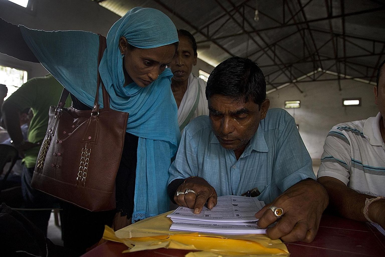 Villagers checking their names in the final National Register of Citizens at a centre in Buraburi village, Morigaon district, in Assam state. Those left off the list will be allowed to challenge their exclusion in tribunals.