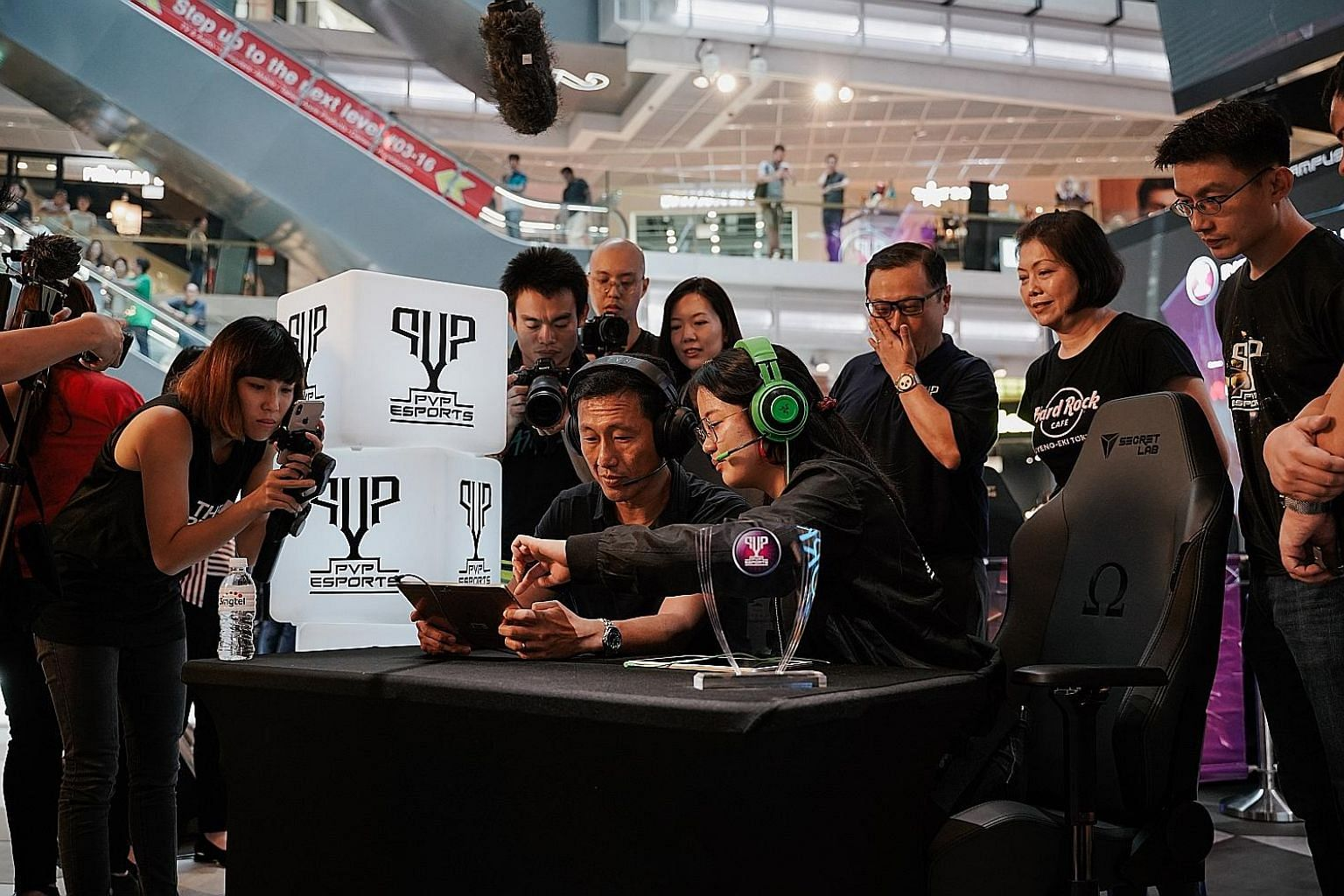 Education Minister Ong Ye Kung trying his hand at popular e-sports game Mobile Legends at Singtel's inaugural PVP Inter-Campus League at Funan mall yesterday.