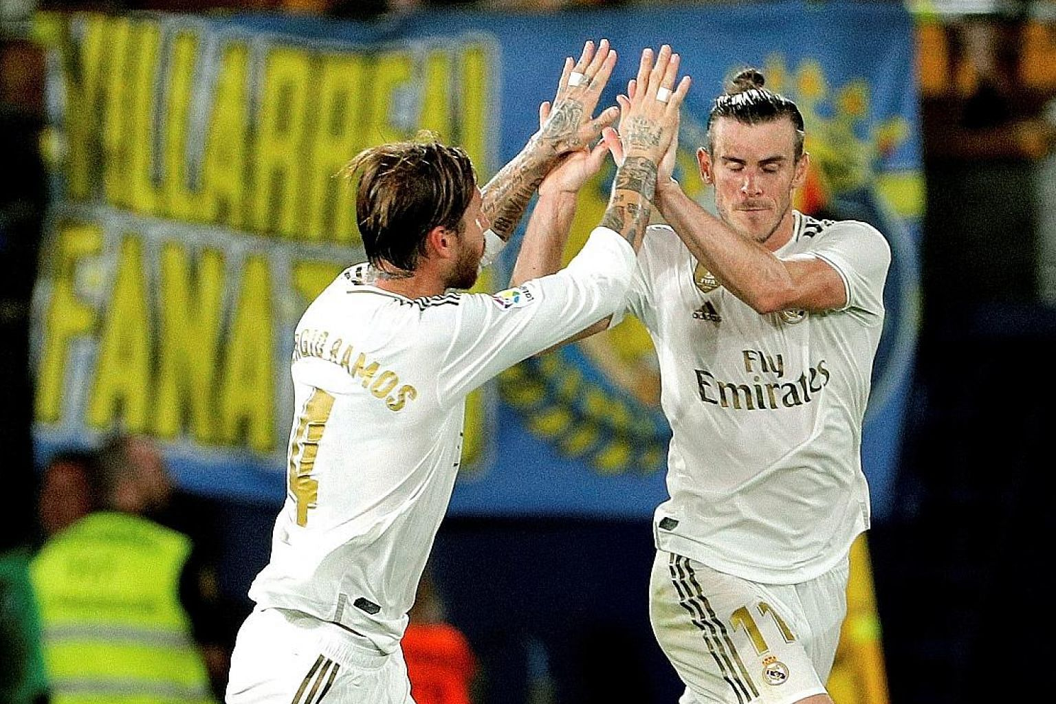 Real Madrid's Gareth Bale celebrates one of his goals against Villarreal with Sergio Ramos. He scored both Real's goals in a 2-2 draw before getting his marching orders. PHOTO: EPA-EFE