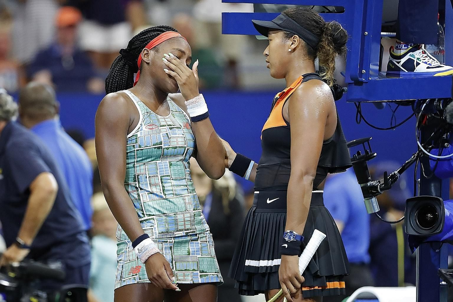Naomi Osaka displaying the magnanimity of a champion in comforting teen sensation Cori Gauff after their match on Saturday. PHOTO: REUTERS