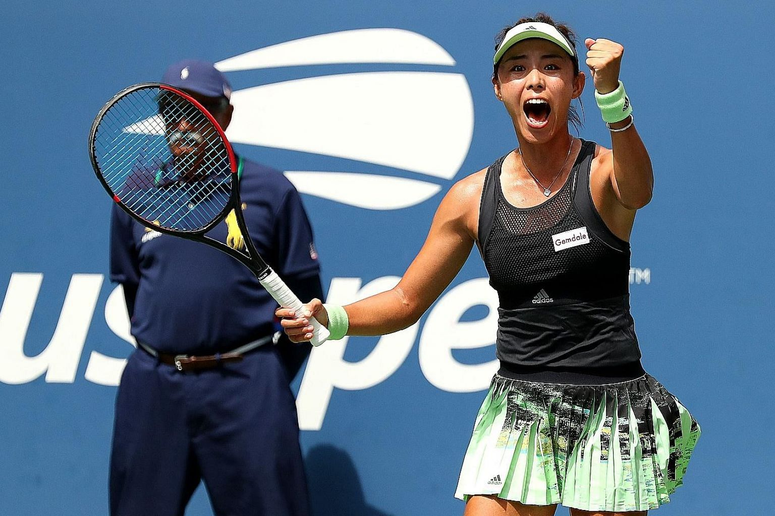 Wang Qiang is ecstatic in celebrating her win over second seed Ashleigh Barty in the fourth round of the US Open. The Chinese 18th seed will face another more-fancied opponent in Serena Williams in the quarter-finals. PHOTO: AGENCE FRANCE-PRESSE