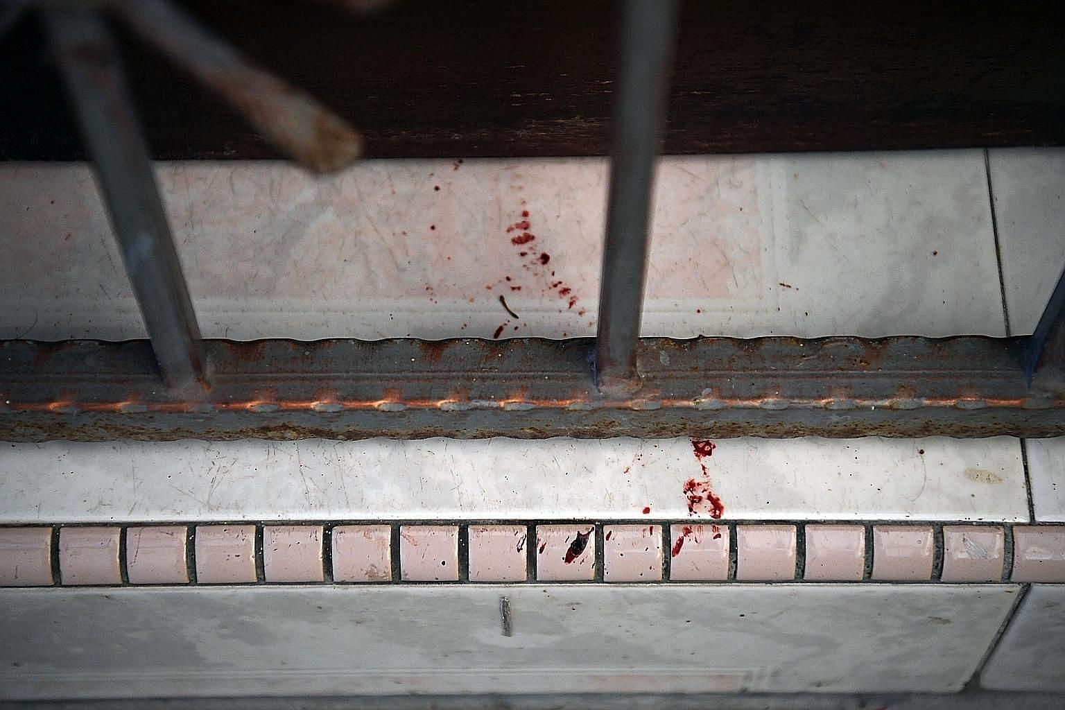 Blood stains on the doorstep of the unit in Block 191 Lorong 4 Toa Payoh. ST PHOTO: KUA CHEE SIONG