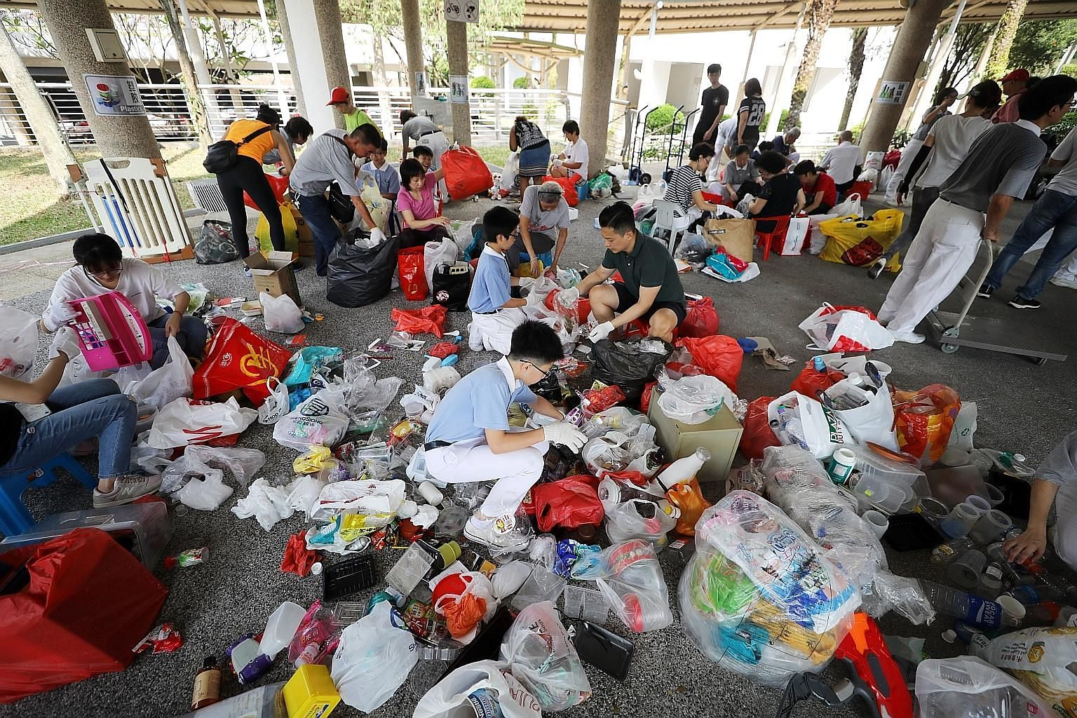 Tzu Chi Foundation volunteers sorting plastic items for recycling earlier this year. The new Act gives regulatory teeth to waste-reducing measures in three streams: e-waste, food waste and packaging waste, including plastics. ST FILE PHOTO