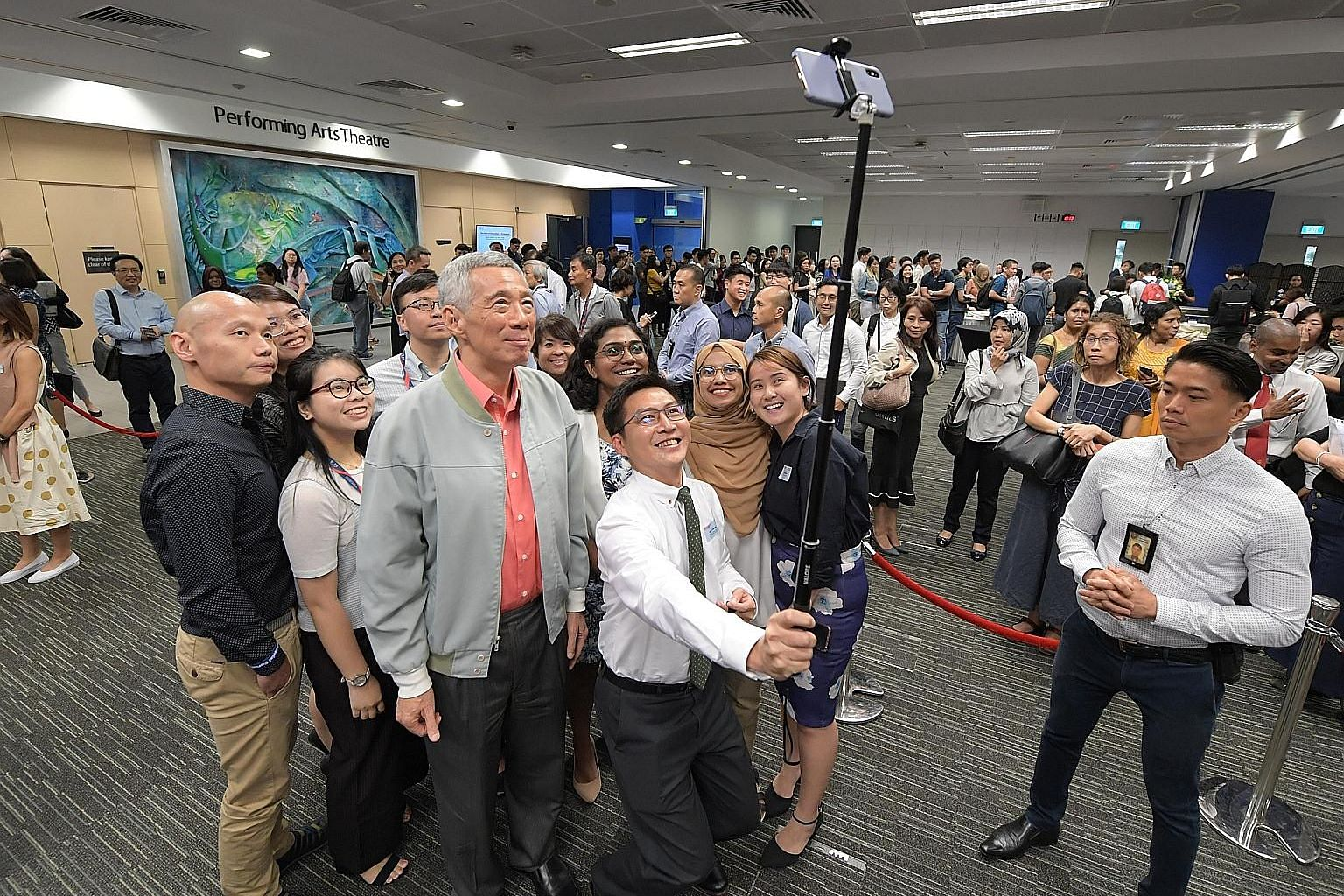 Prime Minister Lee Hsien Loong taking a photo with participants of the Singapore University of Social Sciences' inaugural ministerial dialogue. Among the issues covered during the dialogue were the value of lifelong learning and a university educatio