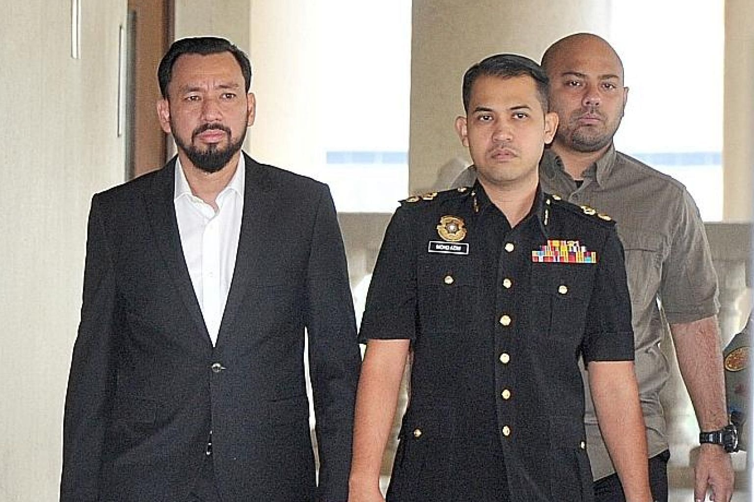 Datuk Amhari Efendi Nazaruddin (far left) is the eighth prosecution witness in the hearing on the alleged role of fugitive financier Low Taek Jho in the 1Malaysia Development Berhad corruption case.