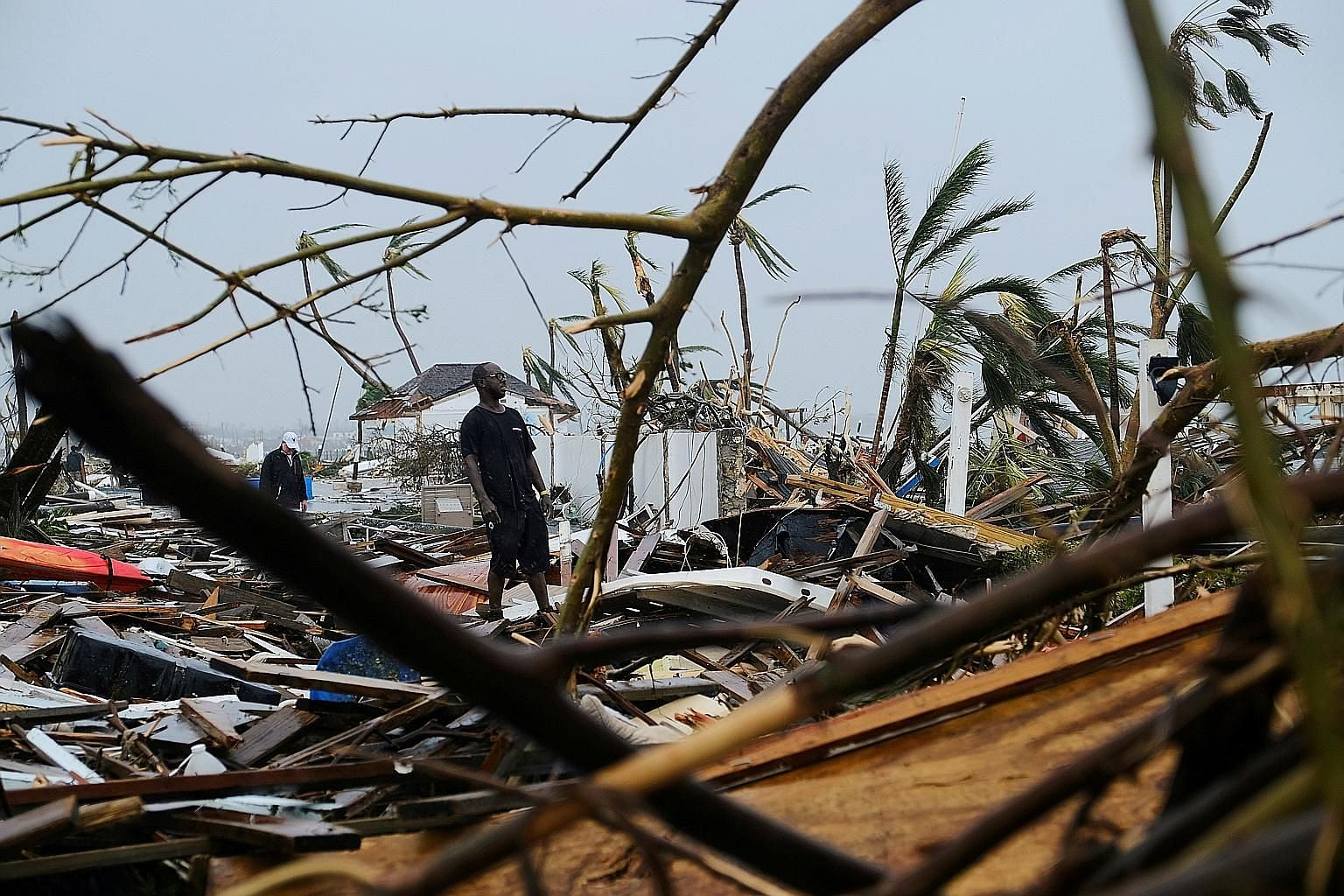 A resident surveying damage in the aftermath of Hurricane Dorian on the Great Abaco island town of Marsh Harbour, Bahamas, on Monday. At least 20 people have been killed and thousands remain missing after the most damaging storm to hit the island nat