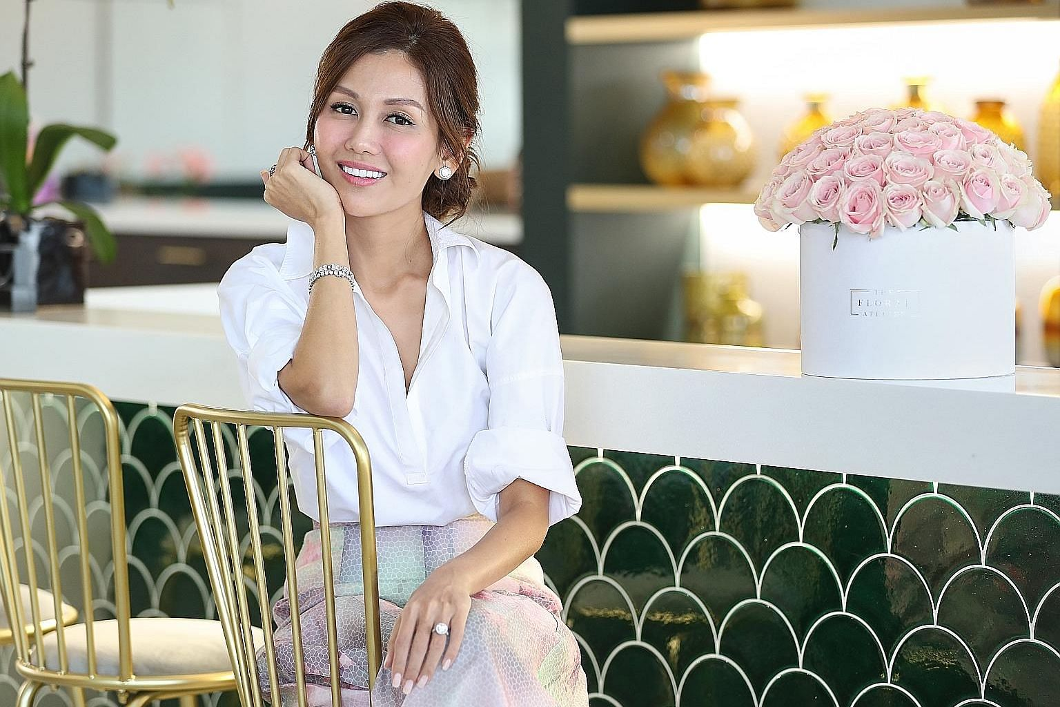 Ms Lelian Chew is beefing up her company's presence in Singapore by setting up its global headquarters in Delta House. The Atelier & Co will house her two businesses - The Wedding Atelier and The Floral Atelier.