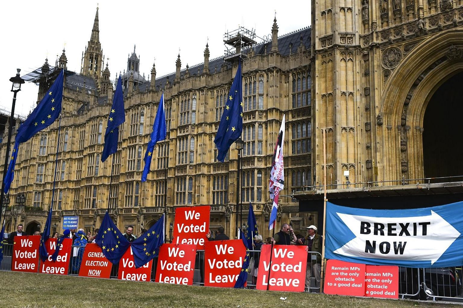 Pro-Brexit placards and European Union flags lining the outside of the Houses of Parliament in London on Thursday.