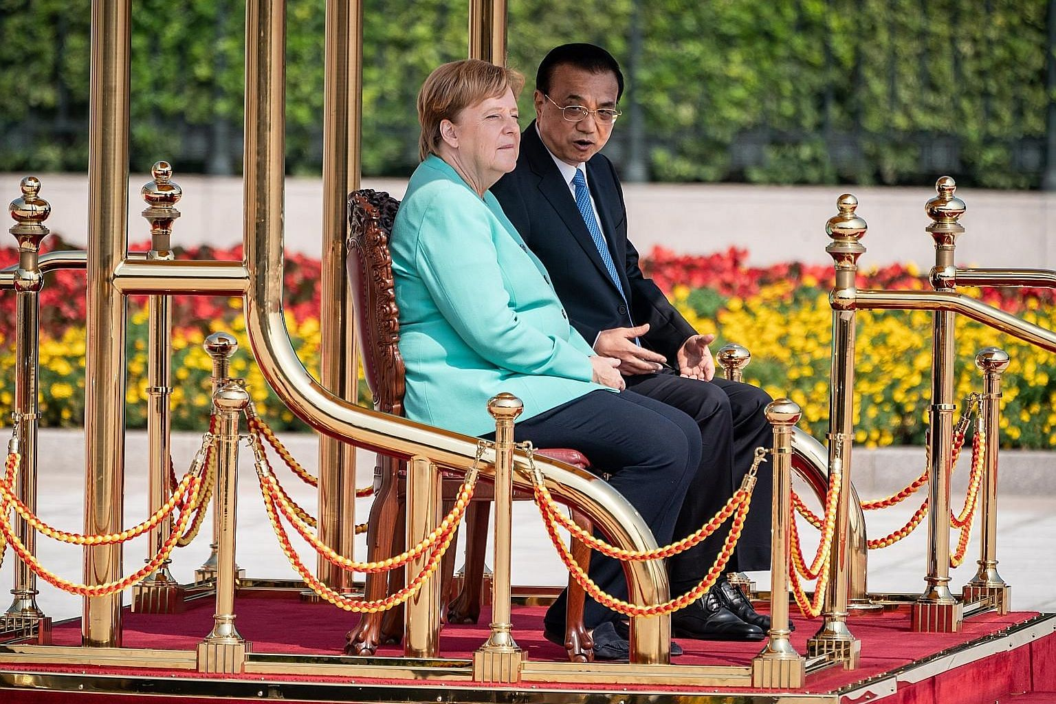 German Chancellor Angela Merkel at a welcome ceremony with Chinese Prime Minister Li Keqiang before their meeting at the Great Hall of the People in Beijing yesterday.