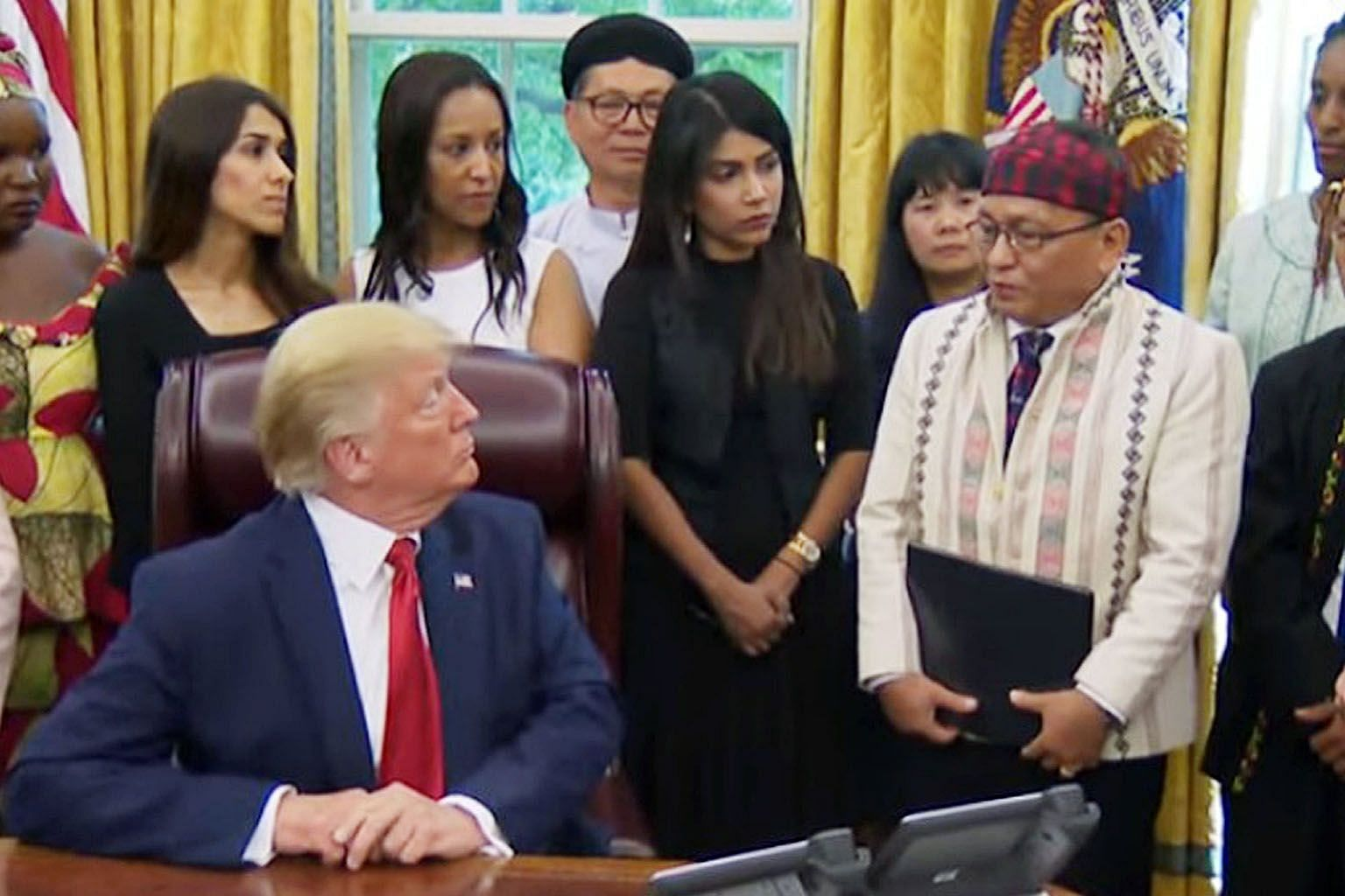Reverend Hkalam Samson (far right) of Myanmar's Kachin Baptist Convention speaking to US President Donald Trump about religious persecution in Myanmar at the White House on July 17. PHOTO: WHITE HOUSE