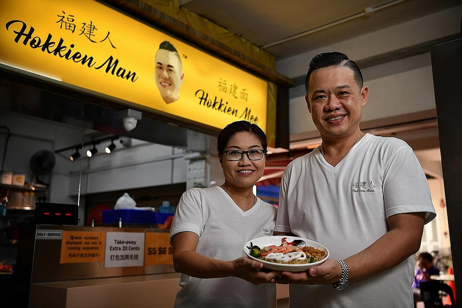 Running the Hokkien mee stall is hard work for Xavier Neo and his wife Alice Lai, but they are determined to press on.