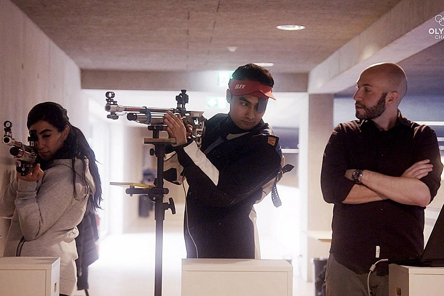 Three-time Olympic shooting gold medallist Niccolo Campriani of Italy (right) training refugees Khaoula (far left) and Mahdi at the World Archery Excellence Centre in Lausanne.