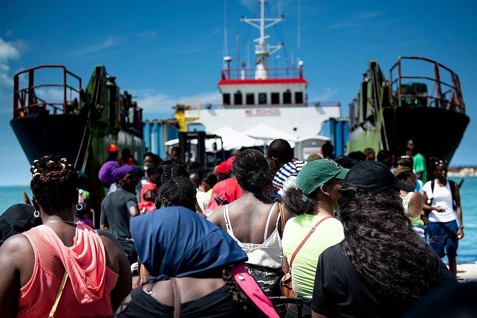 People boarding a cargo ship at a port in Great Abaco on Saturday for evacuation to Nassau, Bahamas, in the wake of Hurricane Dorian.