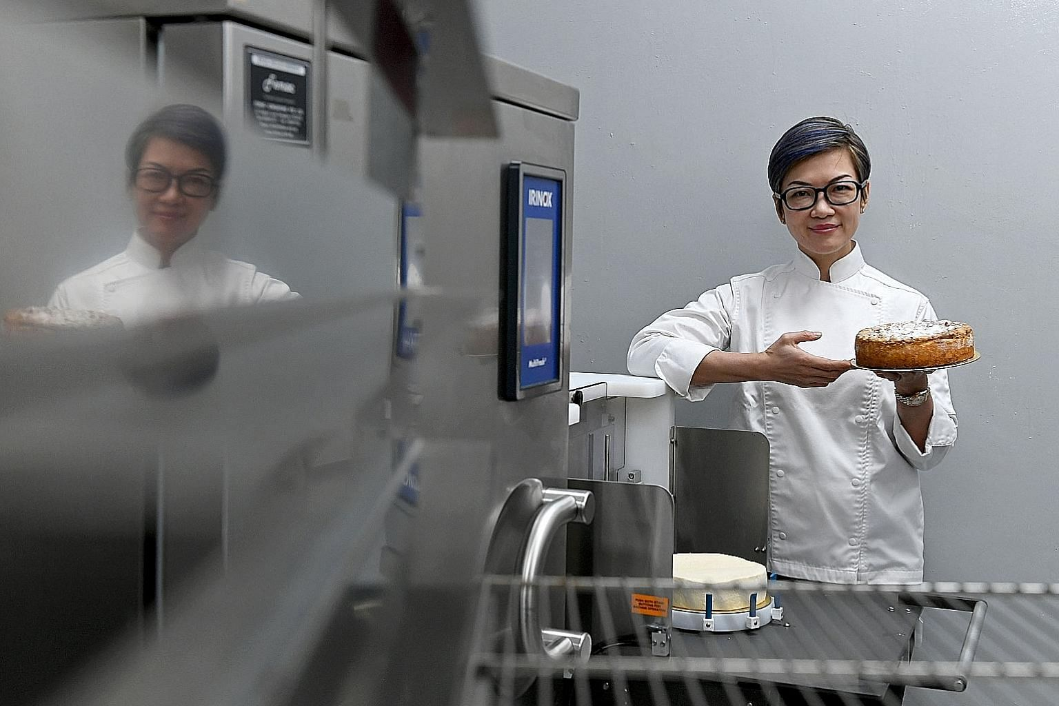 Technology takes care of the more mundane tasks so pastry chef Gwen Lim and her employees can reduce man hours in the kitchen and use their skills more efficiently. ST PHOTO: DESMOND FOO