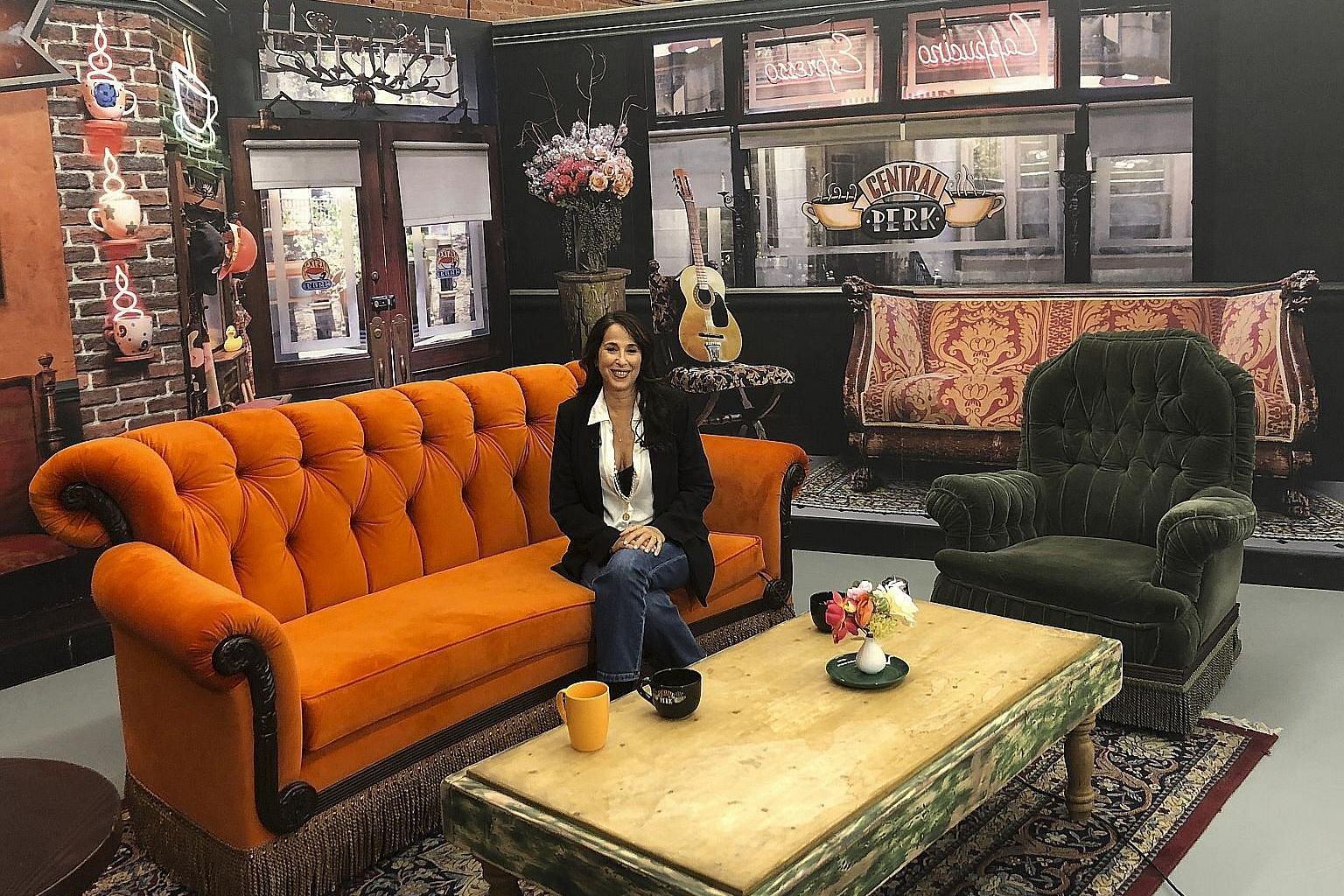 Maggie Wheeler, who played Janice, the character with the annoying nasal laugh on the sitcom Friends, posing at a replica of the Central Perk set at the exhibition.