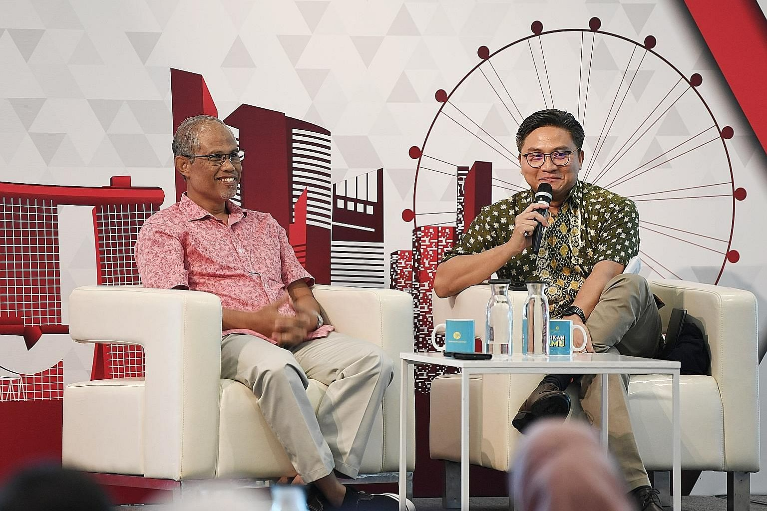Minister-in-charge of Muslim Affairs Masagos Zulkifli (left) and MP Saktiandi Supaat at the dialogue yesterday.