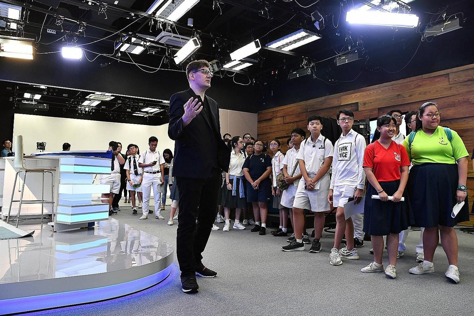 Mr Jonathan Matthew Roberts, creative director at EMTM Video, showing the students around a studio yesterday. The 40 secondary school students were drawn from among more than 300 participants of N.E.mation!, an inter-school digital animation competit