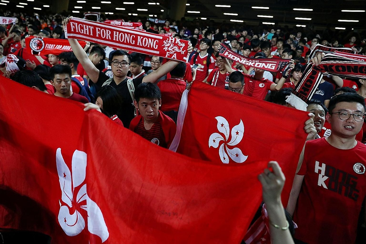 Football fans in Hong Kong Stadium yesterday showing support for anti-government protesters as Hong Kong took on Iran in a World Cup qualifier.