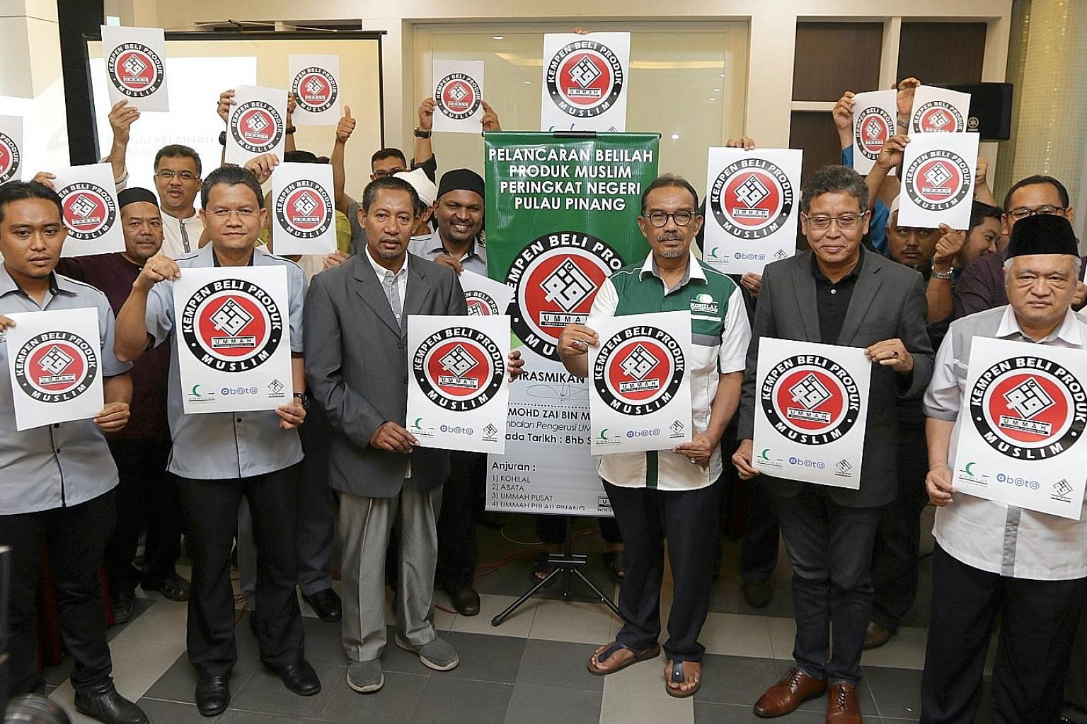 Mr Mohd Zai Mustafa (third from left), national deputy chairman of NGO Ummah, with Muslim entrepreneurs at the Penang launch of the Buy Muslim First campaign at the weekend. What began as a campaign for Muslims to be more vigilant about halal product