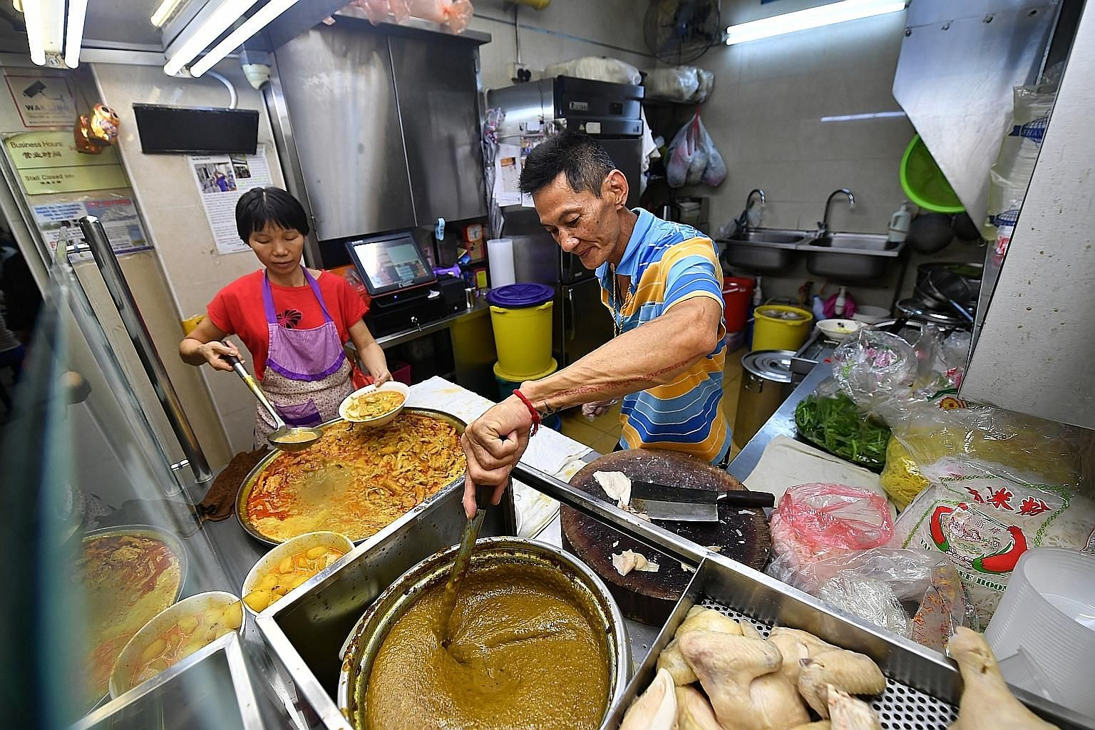Hock Hai (Hong Lim)'s curry chicken noodle dish (left). Two of the new entrants on the list are based at Bedok Interchange Hawker Centre - Bedok Chwee Kueh (above) and Hock Hai (Hong Lim) Curry Chicken Noodle (left). Both stalls had constant queues y