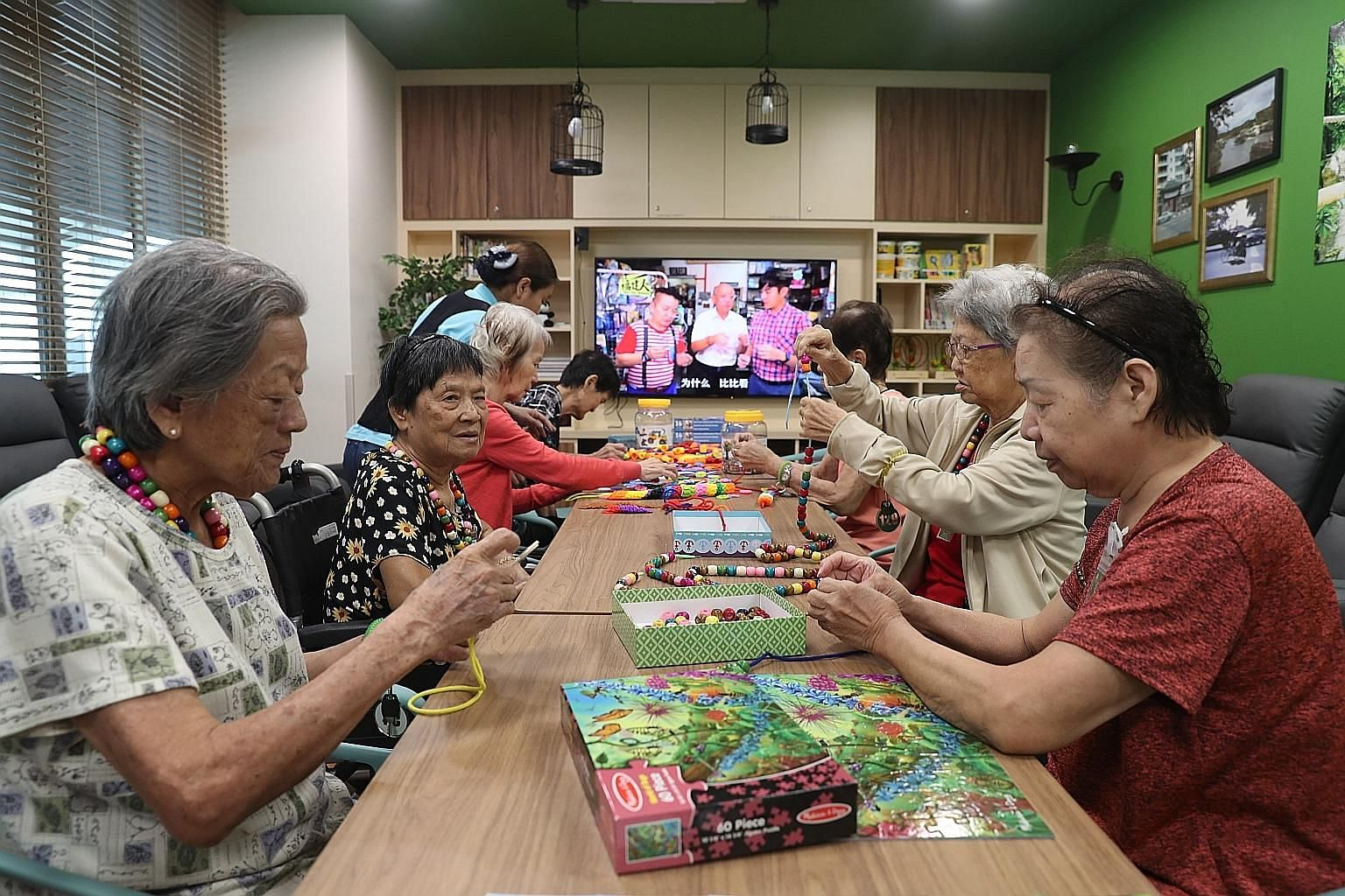 Senior citizens playing board games at the Telok Blangah Senior Care Centre, which was officially launched yesterday.