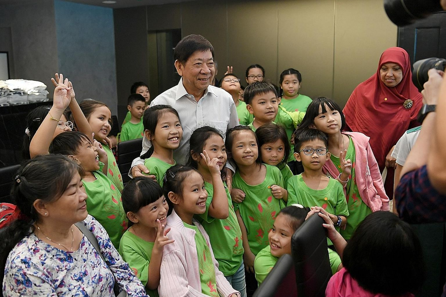 About 60 participants from the Hougang Sheng Hong Student Care Centre yesterday looking at multimedia exhibits that showcase Singapore's cultural history at The Bicentennial Experience at Fort Canning Centre. At the event, Transport Minister Khaw Boo