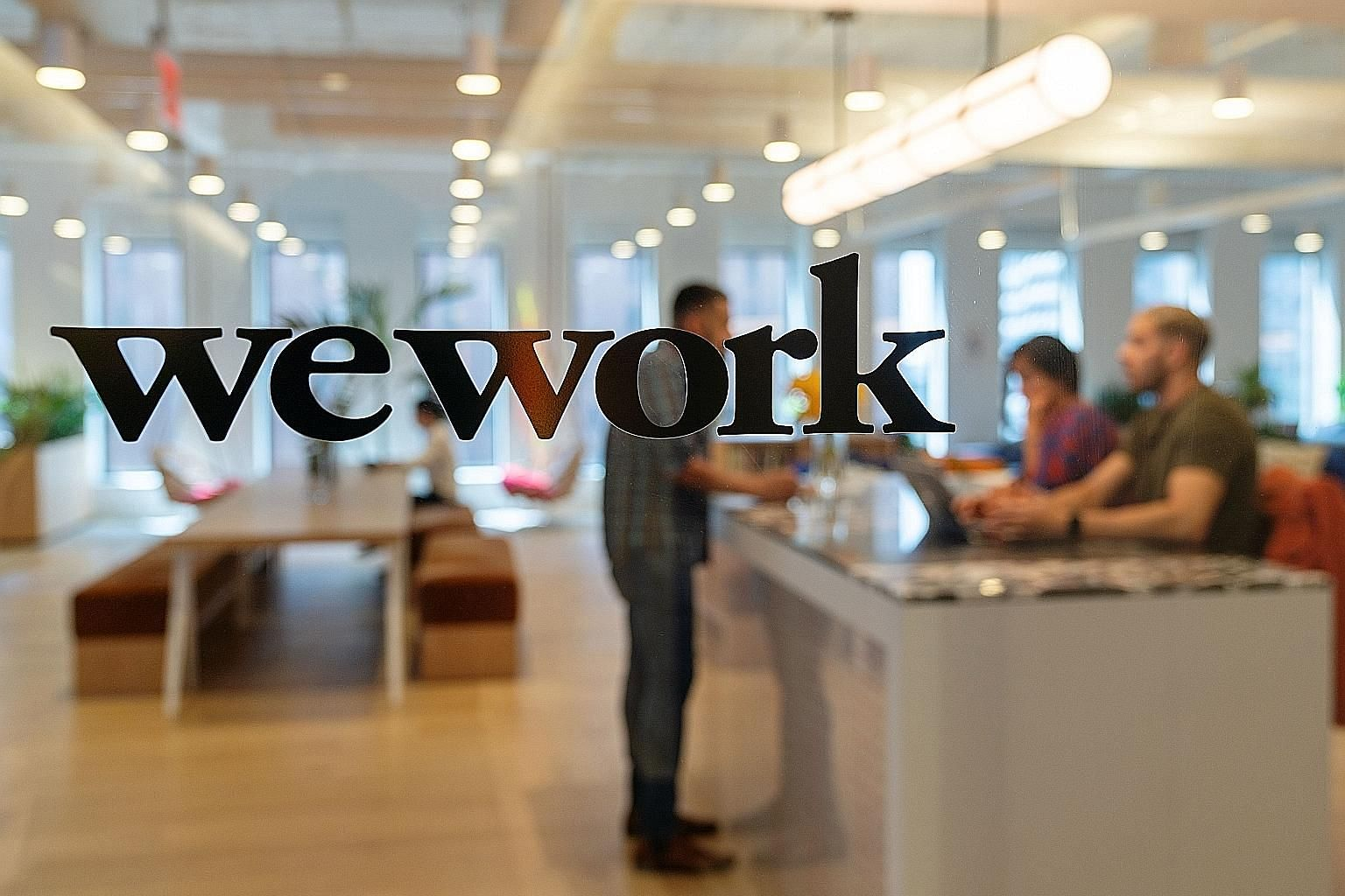 WeWork's parent, The We Company, may seek a valuation as low as US$15 billion (S$21 billion) to US$18 billion in an initial public offering, down from the US$47 billion value it commanded in the last private fund-raising round, a source said. PHOTO: