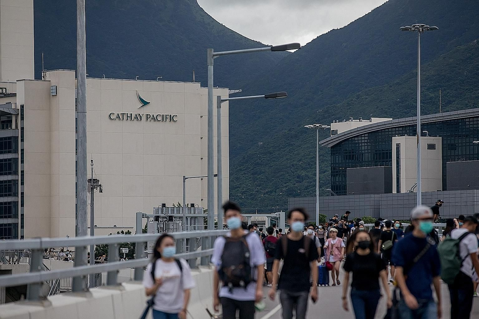 Cathay Pacific said it will cut capacity for the upcoming winter season as the airline battles a slump in demand from travellers avoiding Hong Kong amid massive anti-government protests in the city. PHOTO: BLOOMBERG