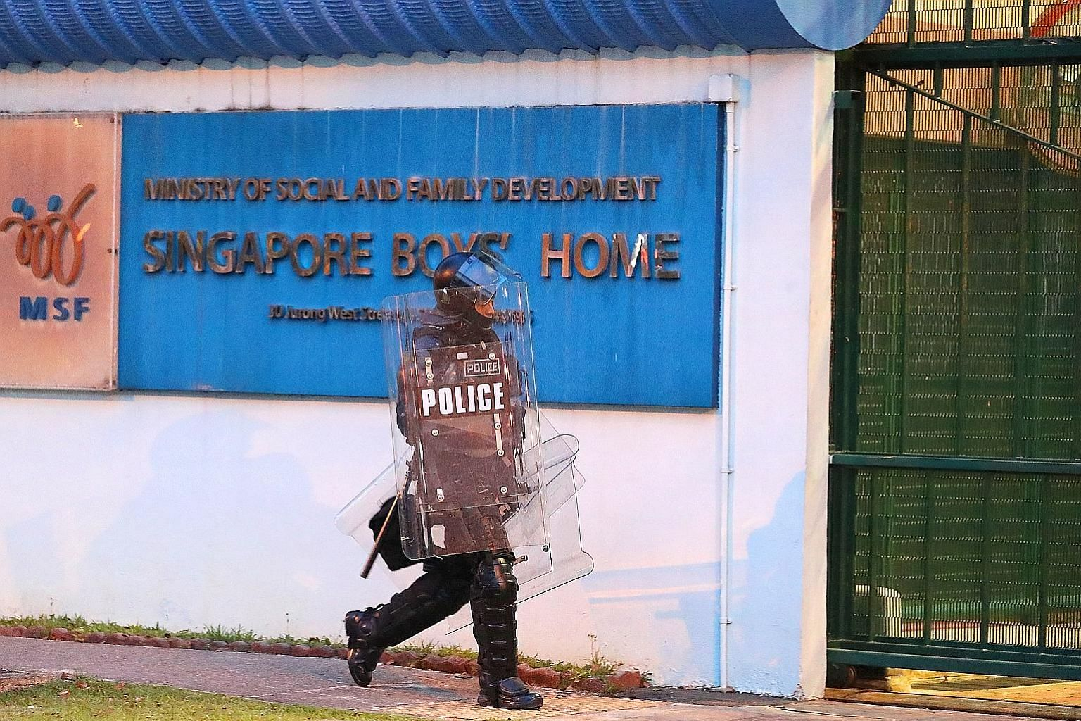 A police officer at the Singapore Boys' Home on Sept 28 last year, when the riot took place. An auxiliary police officer suffered an eye injury, while a youth guidance officer and the home's assistant manager had head injuries.