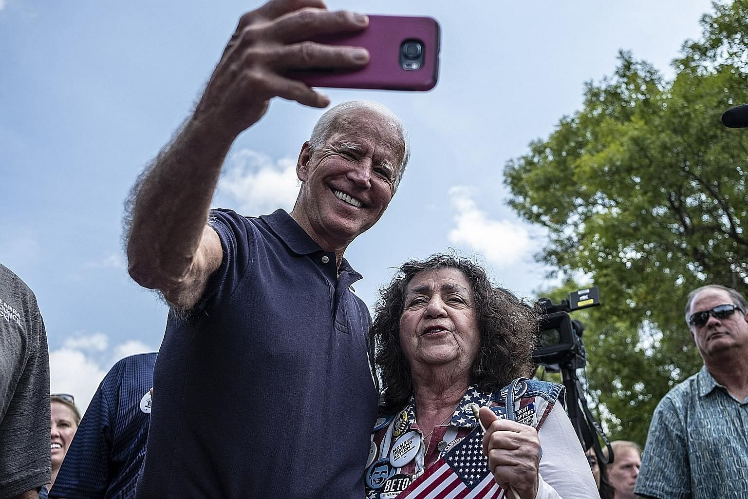 Mr Joe Biden with an attendee at a Labour Day picnic in Cedar Rapids, Iowa, on Sept 2. Despite leading in polls, he has been looking more fallible lately. PHOTO: NYTIMES