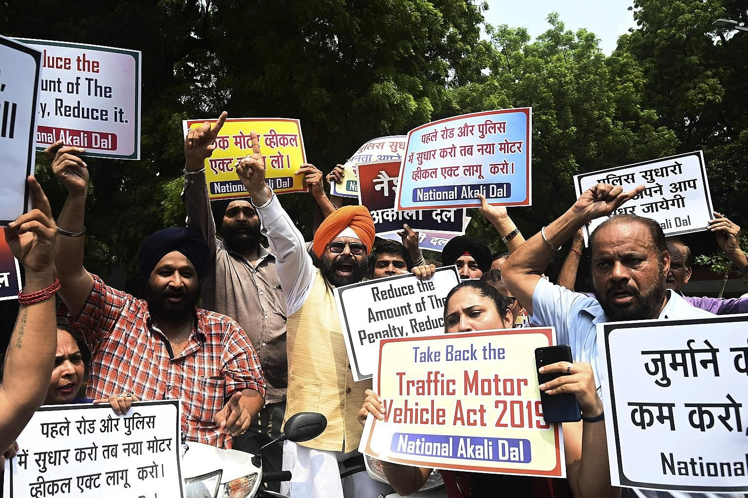 National Akali Dal president Paramjeet Singh Pamma (centre) with supporters of his political party rallying against India's new Motor Vehicle Act in New Delhi on Sunday.