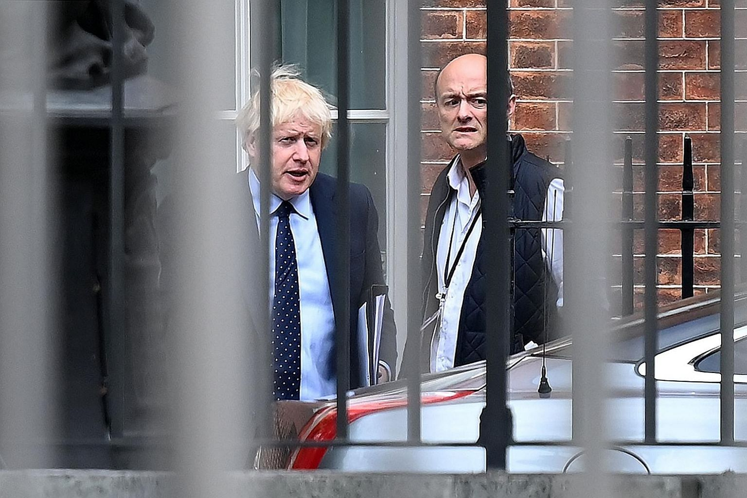 British Prime Minister Boris Johnson (left) with Mr Dominic Cummings, who was behind the government's move to suspend parliamentary debates and the one who came up with the idea of calling early elections. PHOTO: AGENCE FRANCE-PRESSE